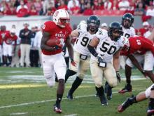Shadrach Thornton (10) rushes during the Wake Forest vs. NC State game on November 10, 2012 in Raleigh, North Carolina.