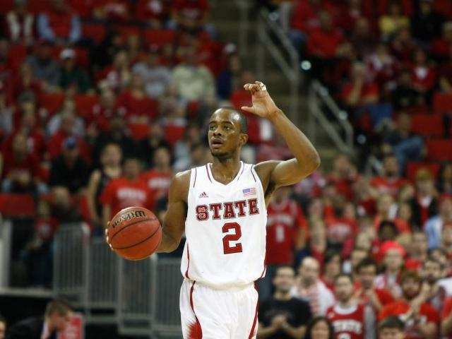 Lorenzo Brown (2) calls out a play on offense during the UNC Asheville vs. NC State game on November 23, 2012 in Raleigh, North Carolina. <br/>Photographer: Jerome Carpenter