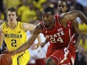 Freshman forward T.J. Warren (24) dribbles up-court during North Carolina State's 79-72 loss to Michigan at Crisler Center in Ann Arbor, Mich. on Tuesday, Nov. 27, 2012.