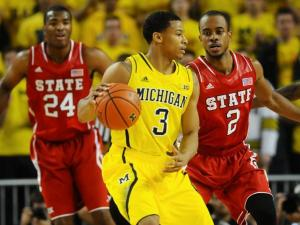 Junior guard Lorenzo Brown (2) and freshman forward T.J. Warren (24) defend Michigan guard Trey Burke (3) during North Carolina State's 79-72 loss to Michigan at Crisler Center in Ann Arbor, Mich. on Tuesday, Nov. 27, 2012.