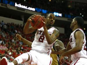 Lorenzo Brown (2) grabs a rebound during the Georgia Tech vs. NC State game on January 9, 2013 in Raleigh, North Carolina.