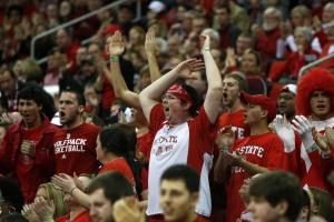 NC State fans disagree with an official's call during the Georgia Tech vs. NC State game on January 9, 2013 in Raleigh, North Carolina.
