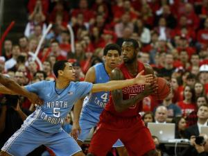 Marcus Paige (5) reaches against C.J. Leslie (5) during the UNC vs. NC State game on January 26, 2013 in Raleigh, North Carolina.