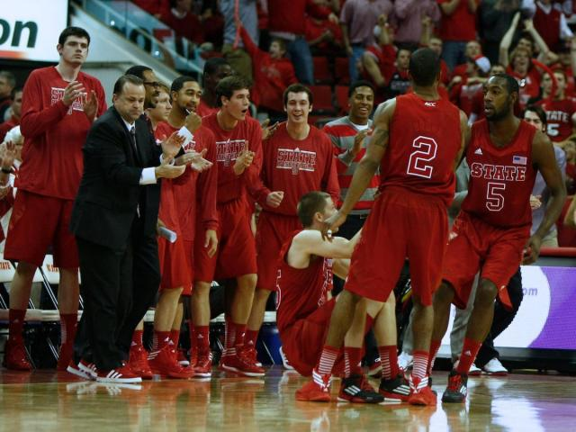 Lorenzo Brown (2) and C.J. Leslie (5) help up Scott Wood (15) as he gets fouled on a made three pointer during the UNC vs. NC State game on January 26, 2013 in Raleigh, North Carolina.<br/>Photographer: Jerome Carpenter