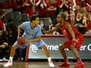 Lorenzo Brown (2) checks Marcus Paige (5) during the UNC vs. NC State game on January 26, 2013 in Raleigh, North Carolina.