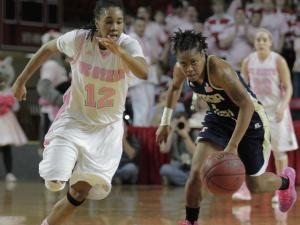 North Carolina State Wolfpack guard Krystal Barrett (12) and Georgia Tech Yellow Jackets guard Dawnn Maye (1) run after the ball during the second half at Reynolds Coliseum in Raleigh N.C.  The Georgia Tech Yellow Jackets defeated the NC State Wolfpack 79-70 Sunday afternoon at Hoops 4 Hope (photo by Wes Hight).