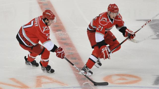 Carolina Hurricanes Ryan Murphy (7)  and Carolina Hurricanes left wing Drayson Bowman (21) during the Hurricanes vs Winnipeg Jets game on February 21, 2013  in Raleigh North Carolina. (Photos By Anthony Barham)