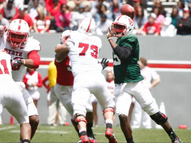 Manny Stocker (15) passes during the NC State Spring Game on April 20, 2013 in Raleigh, NC. <br/>Photographer: Jerome Carpenter