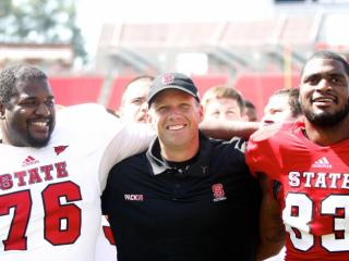 Coach Dave Doeren along with Anthony Talbert (83) and Deylan Buntyn (76) after the NC State Spring Game on April 20, 2013 in Raleigh, NC.