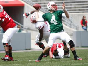 Pete Thomas (4) passes out of the pocket during the NC State Spring Game on April 20, 2013 in Raleigh, NC.