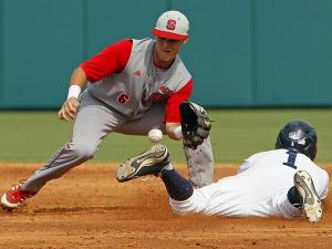 Rice's Leon Byrd (1) beats the throw from catcher to North Carolina State's Logan Ratledge (6) during the second inning of an NCAA college baseball tournament super regional game, Saturday, June 8, 2013, in Raleigh, N.C. (AP Photo/Karl B DeBlaker)
