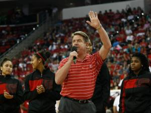 NC State Women's Basketball Coach Wes Moore and his team are introduced during Primetime with the Pack at the PNC Arena in Raleigh, North Carolina on October 18, 2013.