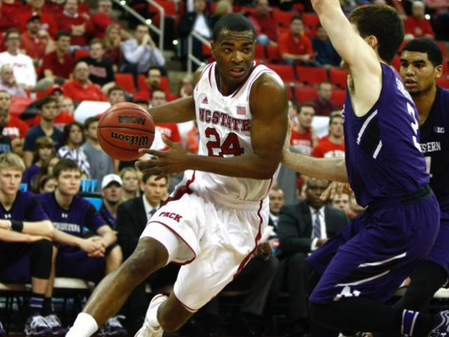 T.J. Warren (24) drives against Dave Sobolewski (3). NC State hosted Northwestern for the ACC/Big Ten Challenge on December 4, 2013 in Raleigh, North Carolina.<br/>Photographer: Jerome Carpenter