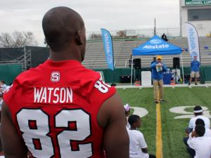 NC State tight end Asa Watson participates in a youth gootball clinic in New Orleans Jan. 1, 2014.