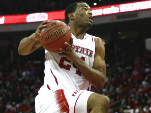 T.J. Warren (24) elevates to go up for a fast-break slam. NC State defeated Wake Forest 82-67 at the PNC Arena in Raleigh, North Carolina on February 11, 2014. Photo by: Jerome Carpenter. <br/>Photographer: Jerome  Carpenter