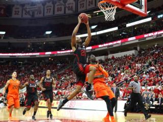 TJ Warren dunks in transition during the second half of the Wolfpack's game Saturday against Miami at PNC Arena. Photo by Jerome Carpenter