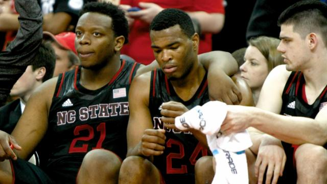 BeeJay Anya (21), T.J. Warren (24), and Jordan Vandenberg (14) in the closing seconds of the game. Miami defeated NC State 85-70 on March 1, 2014 at the PNC Arena in Raleigh, North Carolina. Photo by: Jerome Carpenter