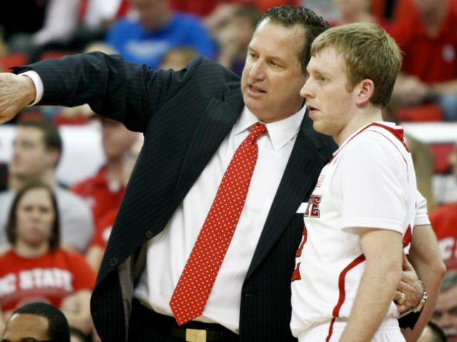 Coach Mark Gottfried instruct Tyler Lewis (12). NC State defeated Boston College 78-68 on March 9, 2014 at the PNC Arena in Raleigh, North Carolina. Photo by: Jerome Carpenter