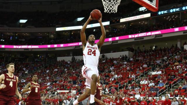 T.J. Warren (24) takes off for a dunk. NC State defeated Boston College 78-68 on March 9, 2014 at the PNC Arena in Raleigh, North Carolina. Photo by: Jerome Carpenter