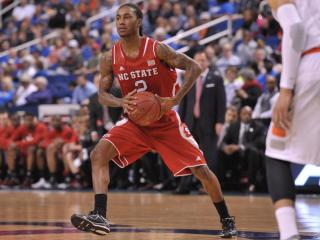 Anthony Barber (2) looks to make a pass during ACC tournament action at the Greensboro Coliseum between the Syracuse Orange and the NC State Wolfpack on March 14, 2014 in Greensboro, NC. (Will Bratton/WRAL contributor)