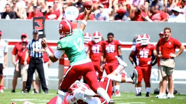 Jacoby Brissett (12) steps into a throw. NC State held their annual Kay Yow Spring Game on April 12, 2014 in Raleigh, North Carolina. Photo by: Jerome Carpenter