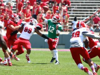 Jacoby Brissett (12) makes a throw from the pocket. NC State held their annual Kay Yow Spring Game on April 12, 2014 in Raleigh, North Carolina. Photo by: Jerome Carpenter