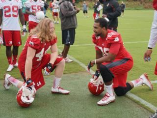 NC State tight ends Devin O'Connor and Benson Browne talk during a break at pracice Saturday in Raleigh.
