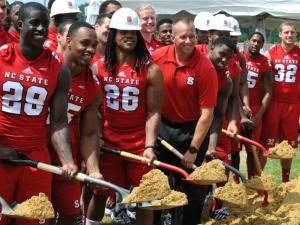 A ceremony to dedicate the Wolfpack's new state-of-the-art indoor practice facility was held on the construction site adjacent to Carter-Finley Stadium Aug. 12, 2014.