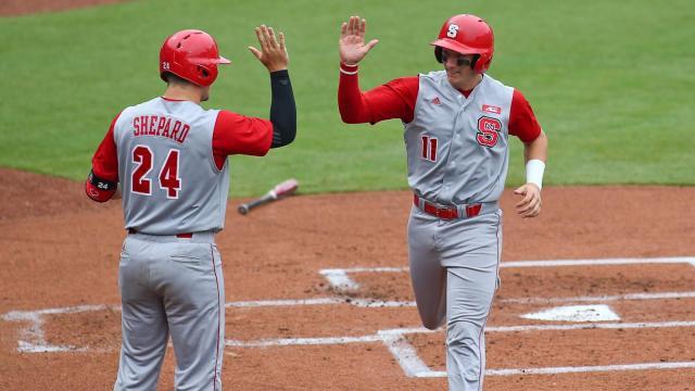 andrew knizner 11 of north carolina state university celebrates an early run - Baseball Christmas