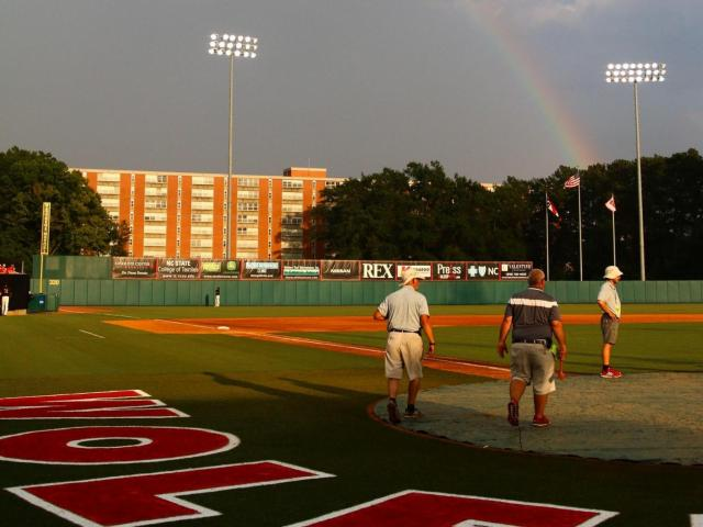 A rainbow appears in the outfield of Doak Field in Raleigh during the NCAA Baseball Regionals.<br/>Photographer: Jerome Carpenter