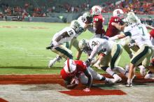 Johnny Frasier (22) punches the ball into the end zone for a score. NC State opened the season with a 48-14 victory over William and Mary on September 1, 2016 in Raleigh, North Carolina. (Jerome Carpenter/WRAL Contributor)
