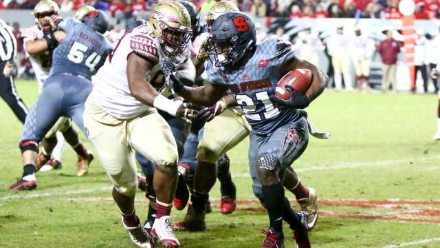 Matthew Dayes (21) runs to the outside with the ball. Florida State defeated NC State 24-20 on November 5, 2016 at Carter-Finley Stadium in Raleigh, North Carolina. (Jerome Carpenter/WRAL Contributor)