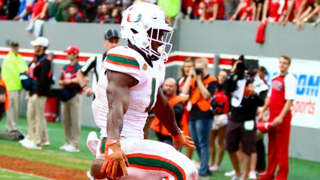Mark Walton (1) scores a touchdown. Miami defeated NC State, by a score of 27-13, on November 19, 2016 in Raleigh, North Carolina. (Jerome Carpenter/WRAL Contributor)