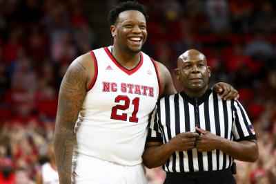 Beejay Anya (21) has some fun with a referee. NC State defeated Virginia Tech 104-78 in their ACC home opener at the PNC Arena in Raleigh, NC on January 4th, 2017. (Photo by: Jerome Carpenter/WRAL Contributor)