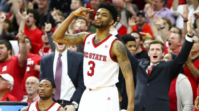 Terry Henderson (3) signals as Maverick Rowan (24) hits a three pointer in the closing seconds of regulation. Syracuse gets by NC State in overtime, 100-93, at the PNC Arena in Raleigh, NC on February 1, 2017. (Photo by: Jerome Carpenter/WRAL Contributor)