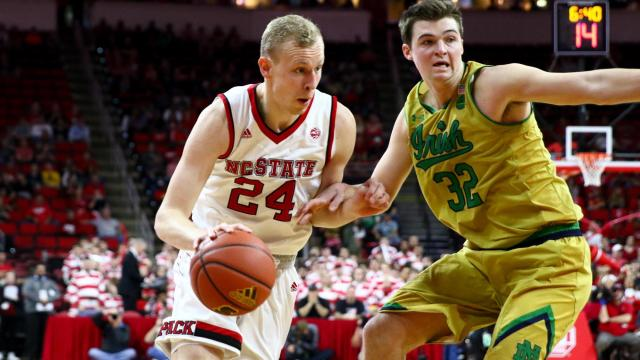 Maverick Rowan (24) drives against Steve Vasturia (32). Notre Dame defeated NC State 81-72 at the PNC Arena in Raleigh, NC on February 18, 2017. (Photo by: Jerome Carpenter/WRAL Contributor)