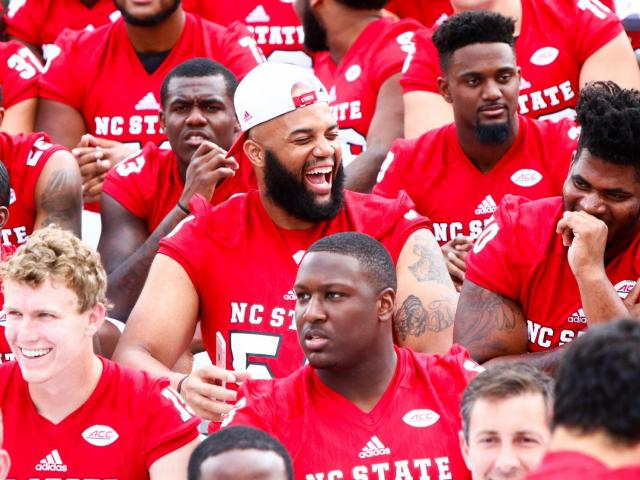 Offensive tackle Will Richardson laughing while waiting for the team photo. NC State Football hosted Meet the Pack Day at Carter-Finley Stadium in Raleigh on August 6, 2017. (Photo by: Jerome Carpenter/WRAL Contributor)<br/>Photographer: Jerome  Carpenter