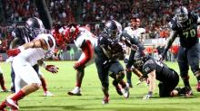 IMAGES: No. 24 NC State upsets No. 17 Louisville 39-25