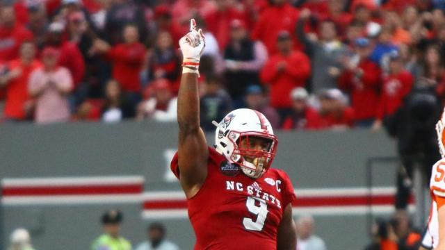 5c6cf07dc Bradley Chubb (9) celebrates after a sack. Clemson defeated NC State 38-