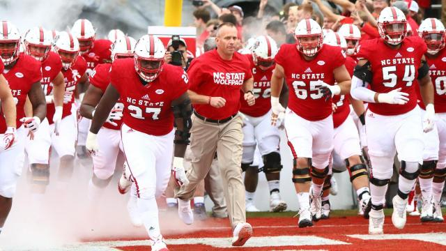 Coach Dave Doeren and the Wolfpack take the field. Clemson defeated NC State  38- 90cecb672
