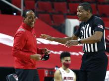 Kevin Keatts talks with ACC referee Ted Valentine