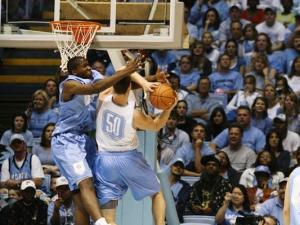Hansbrough tries to get past Ed Davis.