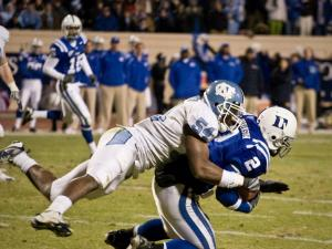 UNC's Bruce Carter tackles Duke's Tielor Robinson in Durham.