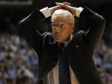 UNC Coach Roy Williams raises his arms in frustration with the officials' calls.
