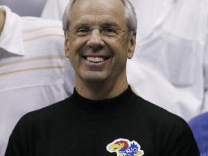 UNC coach Roy Williams wears a Kansas sticker to the NCAA championship game.