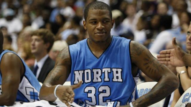 Rashad McCants congratulates team mates during the UNC Alumni game, Friday, September 4, 2009 at the Dean Smith Center in Chapel Hill.  Photo by Todd Melet
