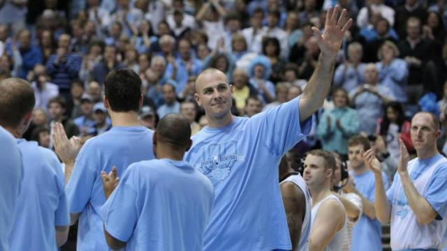 Eric Montross welcomed by an enthusiastic crowd at the Celebration of the Century at UNC's Dean E. Smith Center, Friday, February 12, 2010. Photo by Todd Melet.