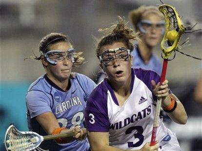 North Carolina's Katy Fitzgerald, left, defends against  Northwestern's Shannon Smith (3) during the first half of the NCAA Women's Final Four semifinal lacrosse game, Friday, May 28, 2010, in Towson, Md. (AP Photo/Rob Carr)