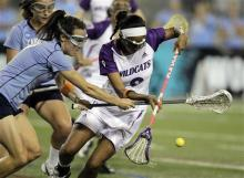North Carolina's Taylor Chumney, left, and Northwestern's Taylor Thornton, right, go after the ball during the first half of the NCAA Women's Final Four semifinal lacrosse game, Friday, May 28, 2010, in Towson, Md. (AP Photo/Rob Carr)