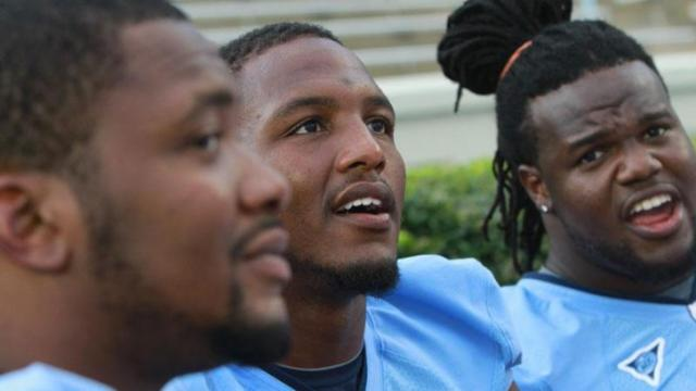 "#42 Robert Quinn (center) at the ""Meet the Heels"" event in 2010."
